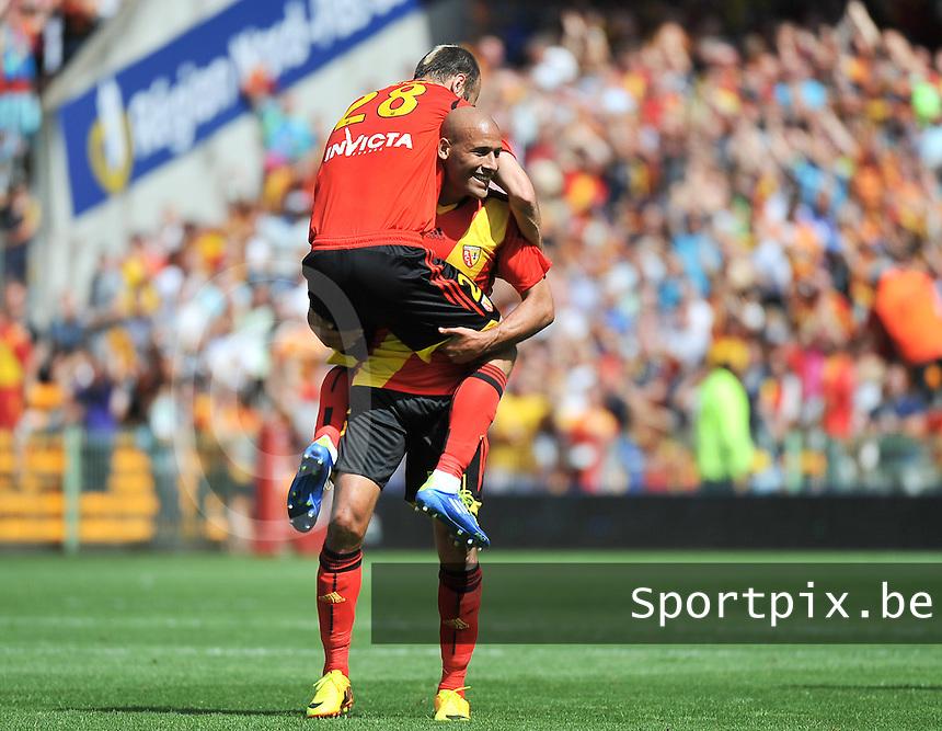 RC Lens - AJ Auxerre : Alaeddine Yahia is celebrating the 3-1 for Lens with Danijel Ljuboja on his back<br /> foto David Catry / nikonpro.be