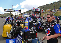 Jul, 22, 2012; Morrison, CO, USA: NHRA top fuel dragster driver Antron Brown is helped by a crew member as he climbs into his car during the Mile High Nationals at Bandimere Speedway. Mandatory Credit: Mark J. Rebilas-