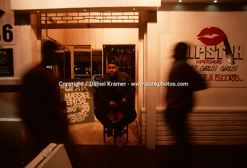 Samoan bouncer Mathew Timaloa works the door outside a brothel in Auckland, New Zealand in 1995.