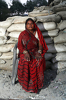 A woman sits near a furnace used for the burning of leather trimmings to make fertiliser and chicken feed on the outskirts of the city of Kanpur. The area is now highly toxic having received the city's industrial waste for many years. Workers have little to no protection.