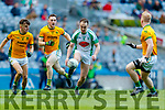 Andrew Barry, Na Gaeil /in action against /Bryan Cody, Rathgarogue-Cushingstown during the AIB GAA Football All-Ireland Junior Club Championship Final match between Na Gaeil and Rathgarogue-Cushinstown at Croke Park on Saturday.