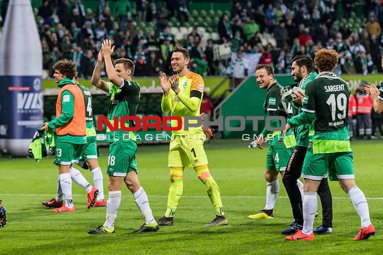 10.02.2019, Weserstadion, Bremen, GER, 1.FBL, Werder Bremen vs FC Augsburg<br /> <br /> DFL REGULATIONS PROHIBIT ANY USE OF PHOTOGRAPHS AS IMAGE SEQUENCES AND/OR QUASI-VIDEO.<br /> <br /> im Bild / picture shows<br /> Niklas Moisander (Werder Bremen #18), Jiri Pavlenka (Werder Bremen #01), Philipp Bargfrede (Werder Bremen #44) lassen sich von Fans nach Spielende feiern, <br /> <br /> Foto &copy; nordphoto / Ewert