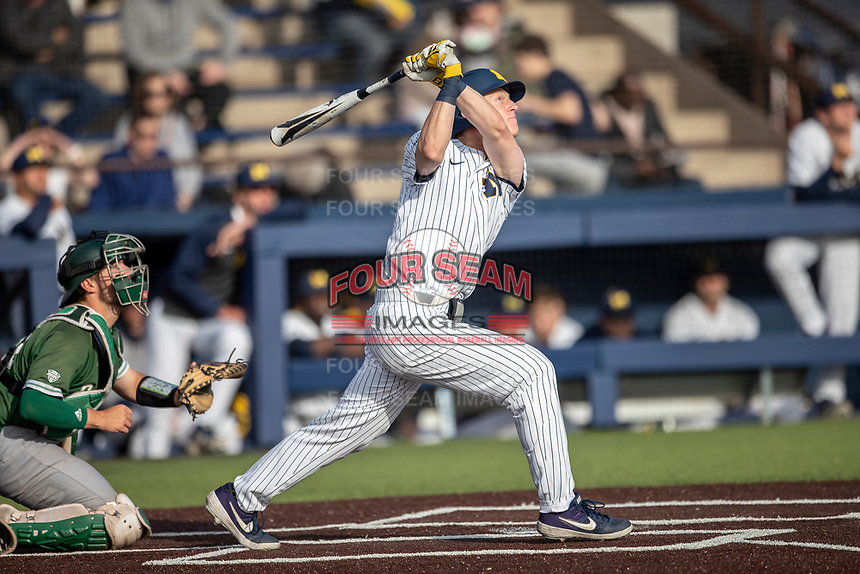Michigan Wolverines first baseman Jimmy Kerr (15) follows through on his swing during the NCAA baseball game against the Eastern Michigan Eagles on May 8, 2019 at Ray Fisher Stadium in Ann Arbor, Michigan. Michigan defeated Eastern Michigan 10-1. (Andrew Woolley/Four Seam Images)