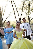 A Quinceanera parades through Pullen Park.
