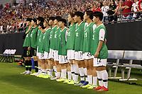 CHARLOTTE, NC - OCTOBER 3: Korea Republic substitutes Kang Yu-mi #12, Kim Jinhui #24, Lee Hyokyeong #19, Hong Hyeji #3, Lee Sodam #14, Park Yeeun #16, Son Hwayeon #22, Lee Youngju #7, Jang Chang #15, Kang Gaae #1, and Min Yukyeong #21 stand for the national anthem during a game between Korea Republic and USWNT at Bank of America Stadium on October 3, 2019 in Charlotte, North Carolina.