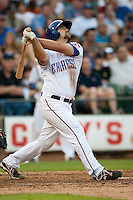 Round Rock Express third baseman Tommy Mendonca #24 swings during the MLB exhibition baseball game against the Texas Rangers on April 2, 2012 at the Dell Diamond in Round Rock, Texas. The Rangers out-slugged the Express 10-8. (Andrew Woolley / Four Seam Images)