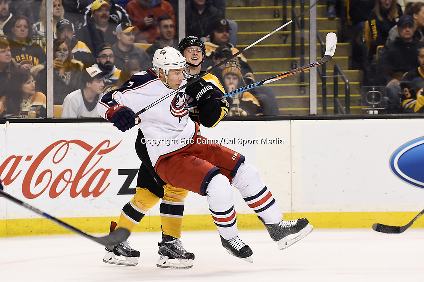 Monday, February 22, 2016:  Columbus Blue Jackets defenseman Jack Johnson (7) loses his footing in front of Boston Bruins defenseman Torey Krug (47) during the National Hockey League game between the Columbus Blue Jackets and the Boston Bruins, held at TD Garden, in Boston, Massachusetts. The Blue Jackets defeat the Bruins 6-4. Eric Canha/CSM<br /> <br /> *** Headline correction *** This corrects an earlier version that headlined the game as Blues vs Bruins FEB 22.