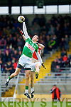 Padraig Lucey Legion gets the touch to the long kick out ahead of Donal O'Sullivan Kilcummin/Rathmore during the County Champship final in Fitzgerald Stadium last Thursday evening