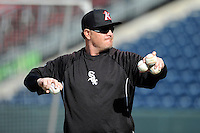 Manager Pete Rose Jr. (14) of the Kannapolis Intimidators throws batting practice prior to a game against the Greenville Drive on Friday, April 11, 2014, at Fluor Field at the West End in Greenville, South Carolina. (Tom Priddy/Four Seam Images)