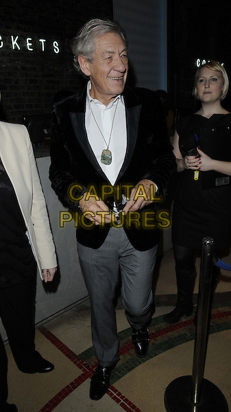 Sir Ian McKellen.attended the 'The Hobbit: An Unexpected Journey' charity screening, Genesis cinema, Mile End Rd., London, England, UK, 21st December 2012..full length black jacket glasses velvet blazer grey gray trousers necklace white shirt .CAP/CAN.©Can Nguyen/Capital Pictures.