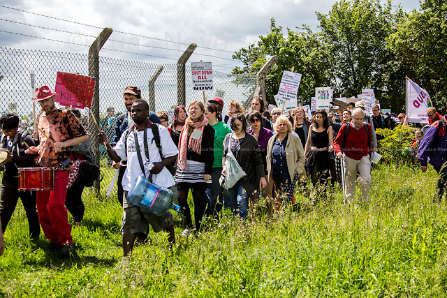 Bedford (Bedfordshire, England), 06/06/2015. Today, hundreds of protesters, activist and member of the public gathered outside the notorious Yarl's Wood I.R.C. Immigration Removal Centre in Bedfordshire, to protest against the alleged inhuman conditions of the detainees (showed in a recent Channel 4 undercover investigation - http://bit.ly/1E6X4pz) and to call for its immediate closure. &lt;&lt;Yarl's Wood Immigration Removal Centre is a detention centre for foreign nationals prior to their deportation from the United Kingdom, one of 13 such centres currently in the UK. It is located near Milton Ernest in Bedfordshire, England, and is operated by Serco (British outsourcing company based in Hook, Hampshire. It operates public and private transport and traffic control, aviation, military weapons, detention centres, prisons and schools on behalf of its customers &ndash; Source Wikipedia.com), who describe the place as &quot;a fully contained residential centre housing adult women and adult family groups awaiting immigration clearance.&quot; Its population is, and has been, overwhelmingly female. [&hellip;]&gt;&gt; (Source - Wikipedia.com at http://bit.ly/1GiTFWB).<br />