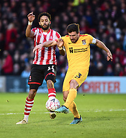 Northampton Town's David Buchanan clears under pressure from  Lincoln City's Bruno Andrade<br /> <br /> Photographer Andrew Vaughan/CameraSport<br /> <br /> Emirates FA Cup First Round - Lincoln City v Northampton Town - Saturday 10th November 2018 - Sincil Bank - Lincoln<br />  <br /> World Copyright &copy; 2018 CameraSport. All rights reserved. 43 Linden Ave. Countesthorpe. Leicester. England. LE8 5PG - Tel: +44 (0) 116 277 4147 - admin@camerasport.com - www.camerasport.com