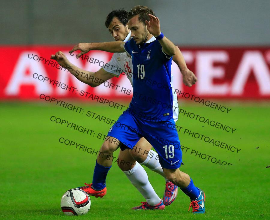 Fudbal<br /> Prijateljski mec-Friendly match<br /> Srbija v Grcka<br /> Michail Bakakis (R) and Danko Lazovic<br /> Chania, 17.11.2014.<br /> foto: Srdjan Stevanovic/Starsportphoto &copy;