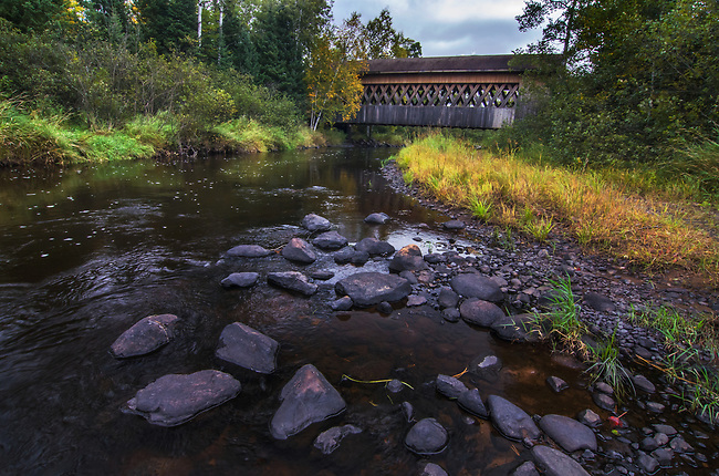 Smith River Rapids Covered Bridge is shown in early autumn, Price County, Wisconsin