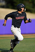 Shortstop Chad Minato (6) of the Harvard Crimson runs out a batted ball in game two of a doubleheader against the Furman Paladins on Friday, March 16, 2018, at Latham Baseball Stadium on the Furman University campus in Greenville, South Carolina. Furman won, 7-6. (Tom Priddy/Four Seam Images)