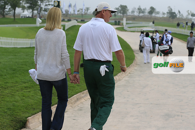 Ernie and Liezl Els (RSA) walk hand in hand to the 10th tee during Saturay's Round 3 of the 2014 BMW Masters held at Lake Malaren, Shanghai, China. 1st November 2014.<br /> Picture: Eoin Clarke www.golffile.ie