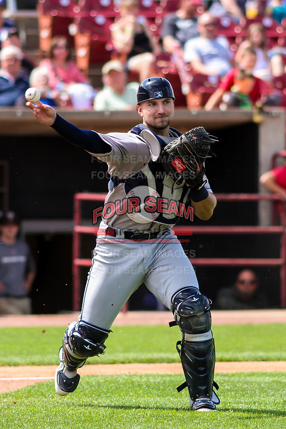 Burlington Bees catcher Harrison Wenson (12) throws to first base during a Midwest League game against the Wisconsin Timber Rattlers on May 19, 2018 at Fox Cities Stadium in Appleton, Wisconsin. Wisconsin defeated Burlington 1-0. (Brad Krause/Four Seam Images)