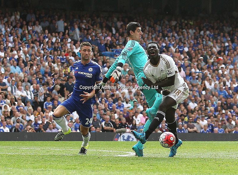 Bafetimbi Gomis of Swansea is fouled by Thibaut Courtois of Chelsea - penalty is given -   during the Barclays Premier League match between  Chelsea and Swansea  played at Stamford Bridge, London