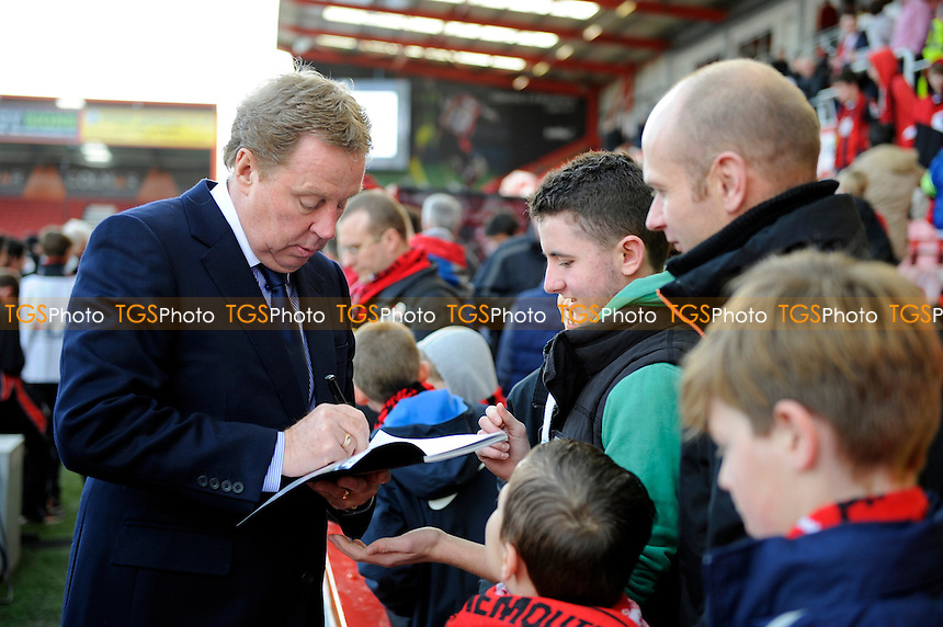Harry Redknapp signs autographs before the game - AFC Bournemouth vs Liverpool - FA Cup 4th Round Football at the Goldsands Stadium, Bournemouth, Dorset - 25/01/14 - MANDATORY CREDIT: Denis Murphy/TGSPHOTO - Self billing applies where appropriate - 0845 094 6026 - contact@tgsphoto.co.uk - NO UNPAID USE