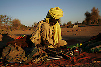 an SLA ( sudan liberation army) child soldier mantains functional his weapon in a forwading base in north darfur on Nov 2004.
