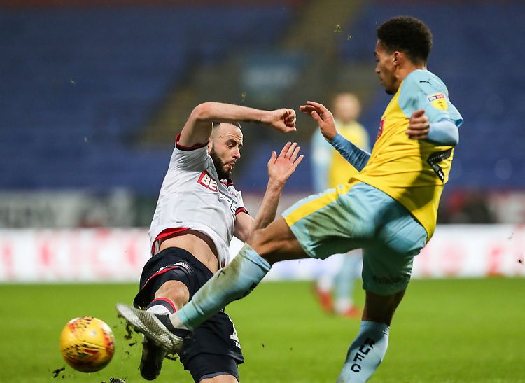 Bolton Wanderers' Marc Wilson competing with Rotherham United's Zak Vyner<br /> <br /> Photographer Andrew Kearns/CameraSport<br /> <br /> The EFL Sky Bet Championship - Bolton Wanderers v Rotherham United - Wednesday 26th December 2018 - University of Bolton Stadium - Bolton<br /> <br /> World Copyright © 2018 CameraSport. All rights reserved. 43 Linden Ave. Countesthorpe. Leicester. England. LE8 5PG - Tel: +44 (0) 116 277 4147 - admin@camerasport.com - www.camerasport.com
