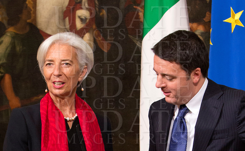 Il Presidente del Consiglio Matteo Renzi accoglie il direttore operativo del Fondo Monetario Internazionale Christine Lagarde (FMI) a Palazzo Chigi, Roma, 10 dicembre 2014.<br /> Italian Premier Matteo Renzi welcomes International Monetary Fund (IMF) Managing Director Christine Lagarde, left, at Chigi Palace government office in Rome, 10 December 2014.