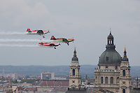 Zoltan Veres aerobatics European champion of Hungary and his formation team perform during an air show above river Danube crossing central Budapest, Hungary on May 01, 2016. ATTILA VOLGYI