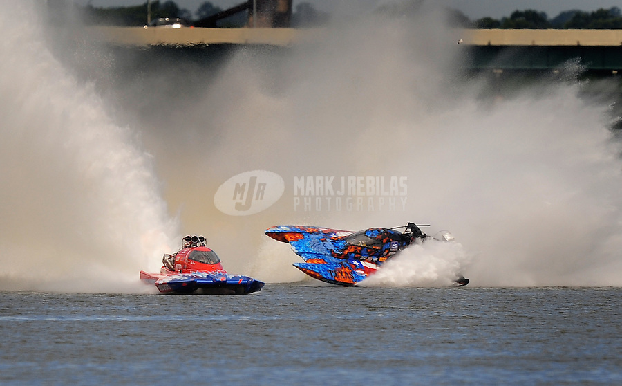 Jul. 18, 2009; Augusta, GA, USA; IHBA top fuel hydro driver Scotty Lumbert (right) loses control and crashes alongside John Haas during qualifying for the Augusta Southern Nationals on the Savannah River. Mandatory Credit: Mark J. Rebilas-