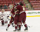 The Eagles celebrate Grieves' first goal of the game. - The visiting Boston College Eagles defeated the Harvard University Crimson 2-0 on Tuesday, January 19, 2016, at Bright-Landry Hockey Center in Boston, Massachusetts.