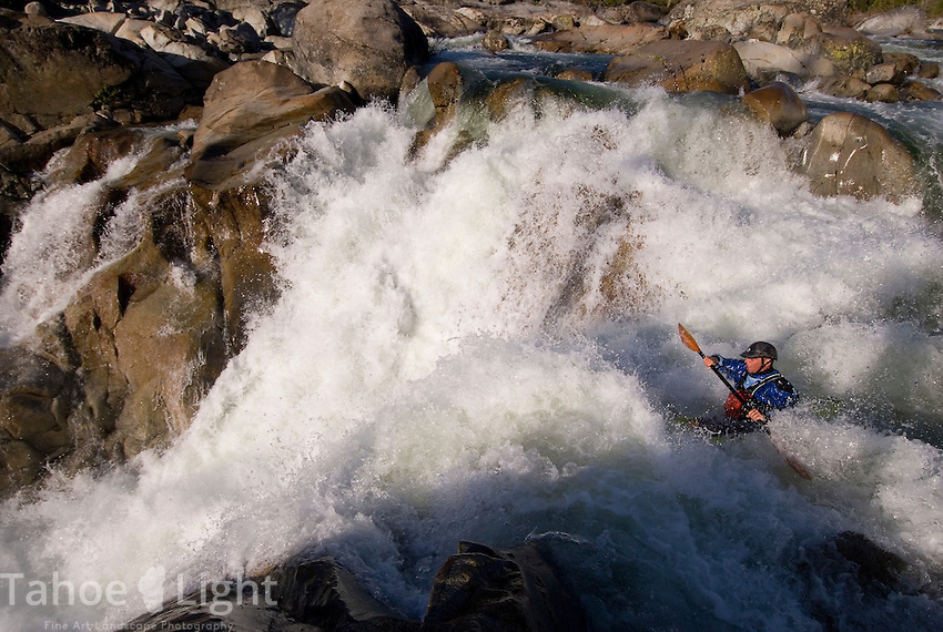 Local kayaker Robby Hogg hits East meets West, a 25 foot waterfall on the SF of the Yuba River near Donner Summit.