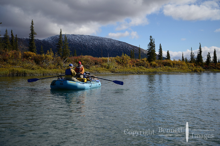 Eric Downey and Cathy Hart float  past a hill capped with newly fallen snow alon the Sheenjek River, which flows south from Alaska's Brooks Range into the Yukon River Flats, in the Arctic National Wildlife Refuge in late August. MR