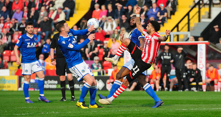 Lincoln City's Bruno Andrade vies for possession with Macclesfield Town's Michael Rose, left, and Macclesfield Town's Nathan Cameron<br /> <br /> Photographer Chris Vaughan/CameraSport<br /> <br /> The EFL Sky Bet League Two - Lincoln City v Macclesfield Town - Saturday 30th March 2019 - Sincil Bank - Lincoln<br /> <br /> World Copyright © 2019 CameraSport. All rights reserved. 43 Linden Ave. Countesthorpe. Leicester. England. LE8 5PG - Tel: +44 (0) 116 277 4147 - admin@camerasport.com - www.camerasport.com
