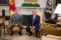 United States President Donald J. Trump meets with Don Bouvet February 9, 2018 at The White House in Washington, DC. In 2017, Trump gave Bouvet's son Shane  $10,000 to pay for cancer treatments for his father. Credit: Chris Kleponis / CNP /MediaPunch