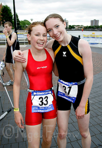 29 JUL 2006 - SALFORD, UK - Winner Lucy Hall (left) celebrates her victory at the British Youth Aquathlon Championships with runner up Kirsty McWilliam (PHOTO (C) 2006 NIGEL FARROW)
