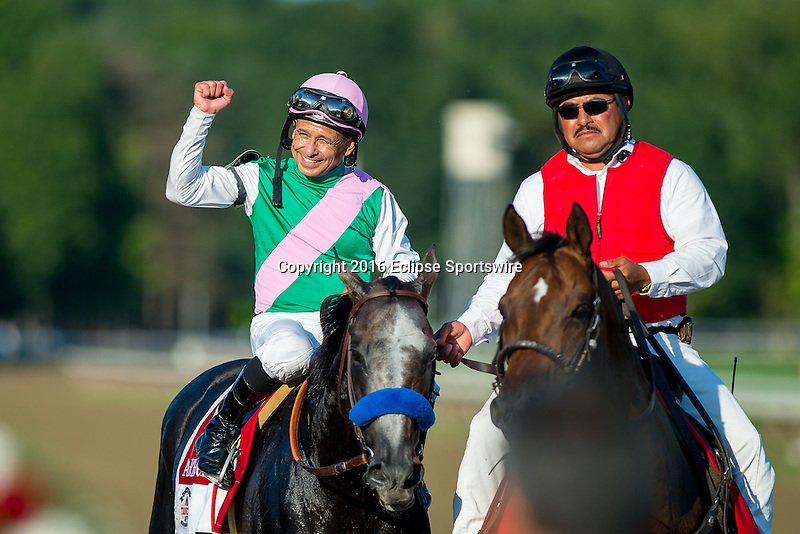 SARATOGA SPRINGS - AUGUST 27: Mike Smith, aboard Arrogate #1, celebrates after winning the the Travers Stakes on Travers Stakes Day at Saratoga Race Course on August 27, 2016 in Saratoga Springs, New York. (Photo by Scott Serio/Eclipse Sportswire/Getty Images)