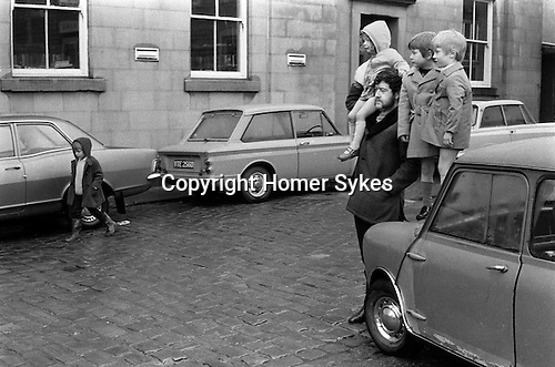 Watching the Britannia Bacup Coconut dancers, Bacup Lancashire 1972.     32/370/1972,