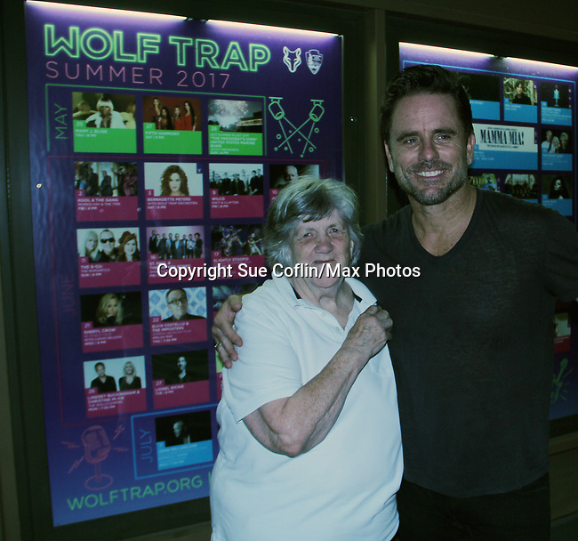 "Nashville's Charles Esten ""Deacon"" performs live in concert and poses with Sue Coflin at WolfTrap, Vienna, Virginia. (Photo by Sue Coflin/Max Photos)"