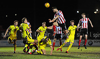Lincoln City's Luke Waterfall attempts to win a high ball at a corner<br /> <br /> Photographer Chris Vaughan/CameraSport<br /> <br /> The EFL Sky Bet League Two - Lincoln City v Cheltenham Town - Tuesday 13th February 2018 - Sincil Bank - Lincoln<br /> <br /> World Copyright &copy; 2018 CameraSport. All rights reserved. 43 Linden Ave. Countesthorpe. Leicester. England. LE8 5PG - Tel: +44 (0) 116 277 4147 - admin@camerasport.com - www.camerasport.com