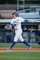 Riley King (32) of the Burlington Royals follows through on his swing against the Bluefield Blue Jays at Burlington Athletic Park on June 29, 2015 in Burlington, North Carolina.  The Royals defeated the Blue Jays 4-1. (Brian Westerholt/Four Seam Images)