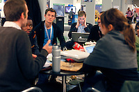 Group discussing inside the conference center. United Nations Climate Change Conference (COP15) was held at Bella Center in Copenhagen from the 7th to the 18th of December, 2009. A great deal of groups tried to voice their opinion and promote their cause in various ways. .©Fredrik Naumann/Felix Features.