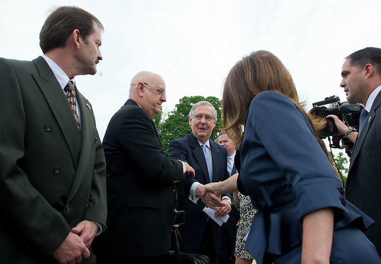 UNITED STATES - May 16: Rep. Michele Bachmann, R-MN., greets Sen. Mitch McConnell, R-KY., to her press conference being held on the East Front of the U.S. Capitol with other Tea Party leaders on IRS.(Photo By Douglas Graham/CQ Roll Call)