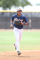 Aldemar Burgos (12) of the AZL Padres returns to the dugout during a game against the AZL Rangers at the San Diego Padres Spring Training Complex on July 5, 2015 in Peoria, Arizona. Padres defeated Rangers, 9-2. (Larry Goren/Four Seam Images)