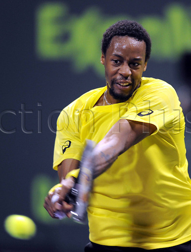03.01.2014. Doha, Qatar.  Gael Monfils of France returns the ball during the men s singles semifinal match against Florian Mayer of Germany in Qatar Open tennis tournament, Jan. 3, 2014. Monfils won 2-0.