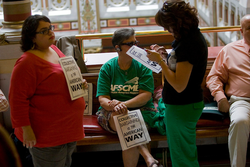 HARTFORD: 062911JT023:.From left, Deanna Chaparro, Joyce Evoy, Dena Fleno, members of AFSCME, show their support of collective bargaining at the Capitol on Thursday during a special legislative session on the budget. .Photo by Josalee Thrift
