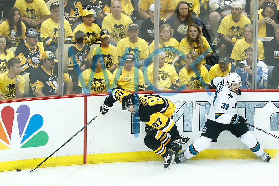 Sidney Crosby #87 of the Pittsburgh Penguins skates away from Logan Couture #39 of the San Jose Sharks with the puck in the second period during game five of the Stanley Cup Final at Consol Energy Center in Pittsburgh, Pennsylvania on June 9, 2016. (Photo by Jared Wickerham / DKPS)