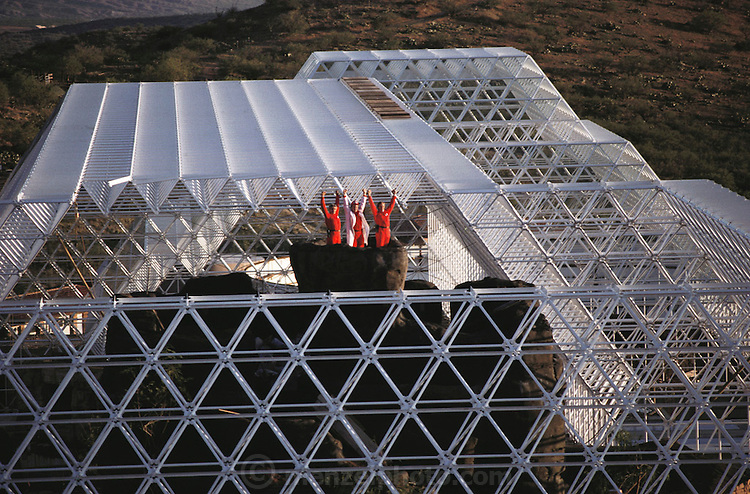 Biosphere 2 Project undertaken by Space Biosphere Ventures, a private ecological research firm funded by Edward P. Bass of Texas.  Three of the eight candidates for the Biosphere 2 Project, seen at the top of the Biosphere 'mountain' during construction (Norberto Alvarez-Romo Taber McCallum, Bernd Zabel). 1990