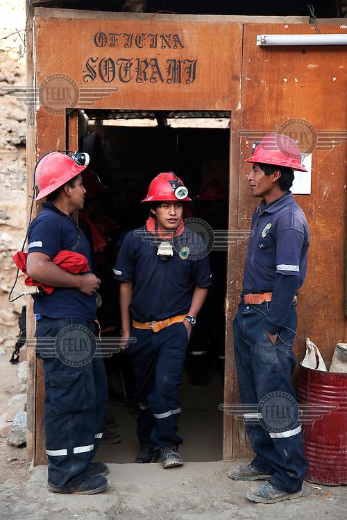 After gathering at 7:00am to attend a safety procedures meeting, miners prepare to enter the gold mine in Santa Filomena in the department of Ayacucho. The gold mine is at 2450m above sea level and it sprawls across galleries that reach some 250m below the ground level.