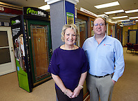 Deborah Schmalbach (L) and Glenn Adams of Tom Adams Windows and Carpets pose in the showroom Monday, March 9, 2015 in Richboro, Pennsylvania. The business, which  started in 1955 as a one-person company going door to door, making sales of storm windows from the back of a pickup truck is celebrating their 60th Anniversary. (Photo by William Thomas Cain/Cain Images)