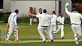 Cricket Scotland Scottish Cup - Uddingston CC V Dunfermline CC at Arbroath CC - Uddy Pro Ras Priyadarshana raises his arm to celebrate the wicket of Dunfermline's Vasu Reddy (left) - Priyadarshana took three wickets in the match - Picture by Donald MacLeod - 20.08.11 - 07702 319 738 - www.donald-macleod.com