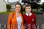 Luke Enright standing with his mom Lorna graduating from Moyderwell NS on Friday.